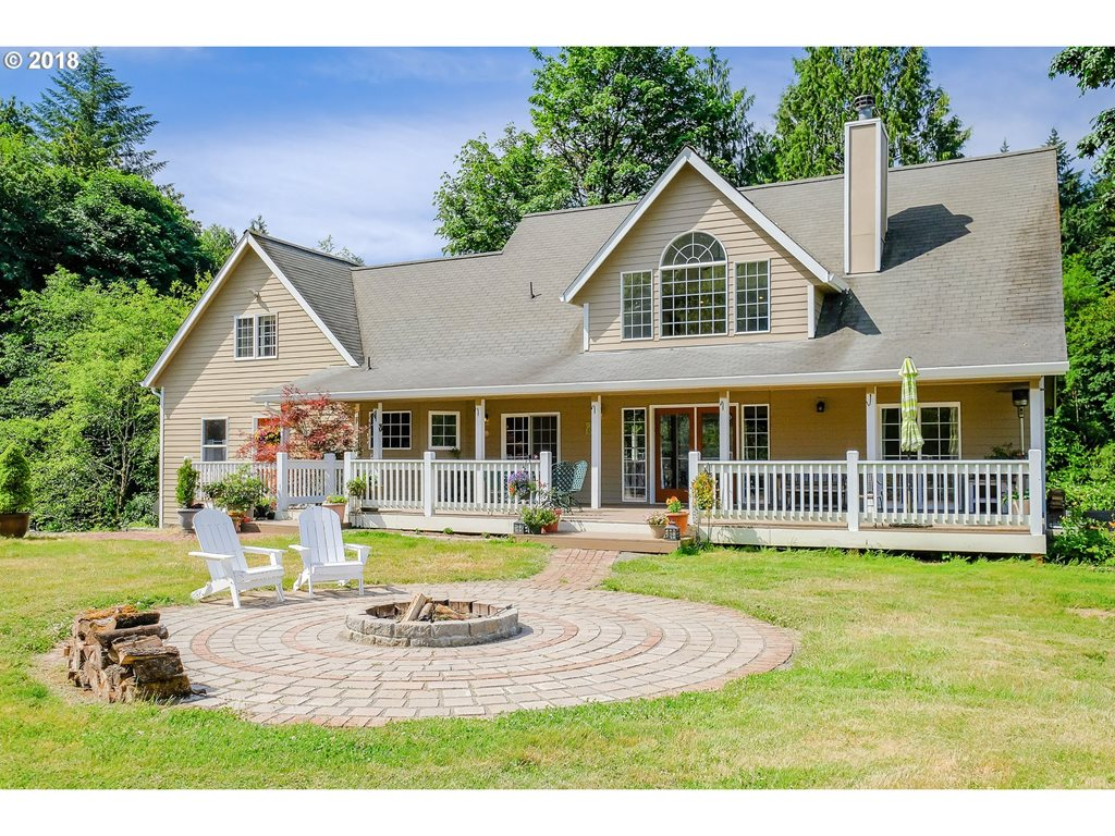 Incredible acreage in Portland! Spacious, well maintained, traditional home on 4.22 acres w/beautiful surroundings! Large master ste & attached bath on main floor w/slider to deck. Vaulted Family room opens to nook & updated kitchen w/laminate floors, Corian counters, & SS appliances. Incl studio/in-law ste w/ sink/counter & full bath. Huge mature yard, deck, patio, and firepit. Property incl 2 creeks, shop, & abundant natural beauty!