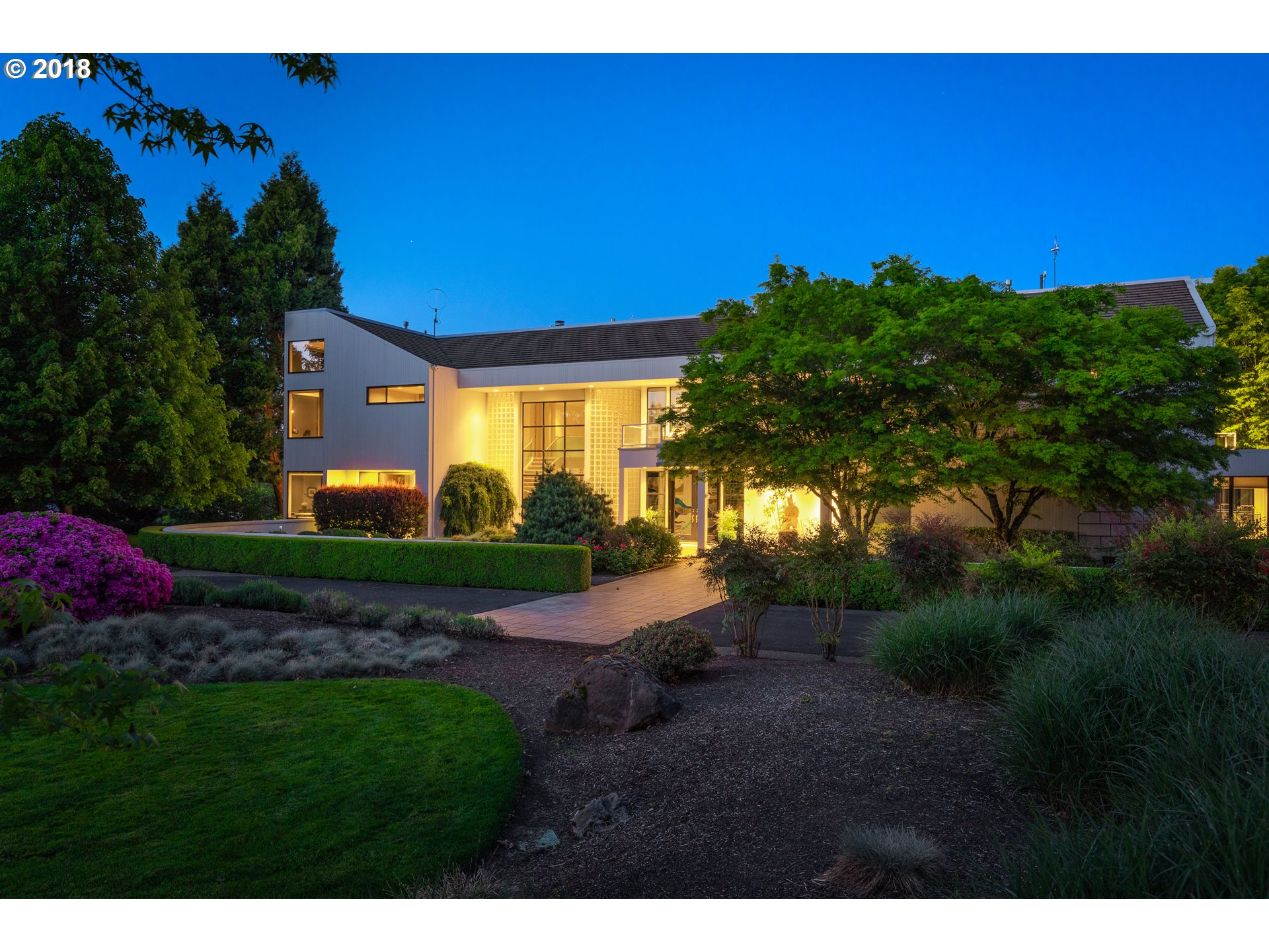 Modern 7,094 sq. ft. home in West Linn gated community on 20 park-like acres. Custom designed with amazing indoor pool & spa house with telescoping doors that open to patio. Gorgeous finishes throughout incl Birdseye cherry & zebrawood, chefs kitchen with deluxe appliances, sound-isolated home theater, 5 bedrooms & 6 baths incl. 2nd master on main. Fully automated light and audio control throughout. Beautiful pond with creek & grounds.
