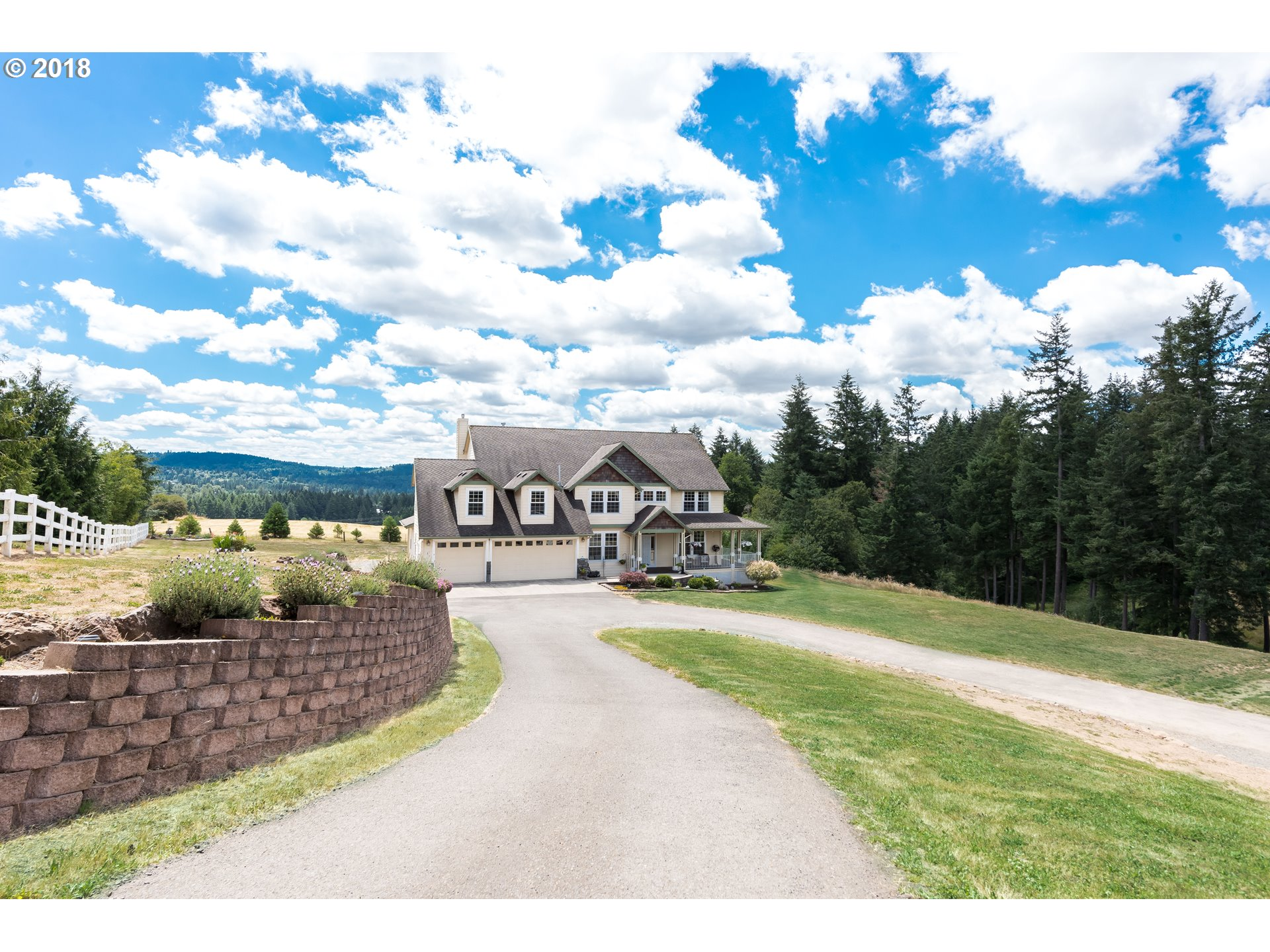 Country living only 7 minutes from I205! Exquisite traditional home w/ charming wrap around porch. Phenomenal views from every window. Kitchen with stainless & walk in pantry. Wine cellar,central vac,great room,above ground pool,3 car xdeep garage.Bonus room upstairs for playing inside, 1.9 acres for playing outside!18x36' freestanding shop with custom shelving, heating and 220 power. Pool can be removed if buyer wishes. Hm warranty inc
