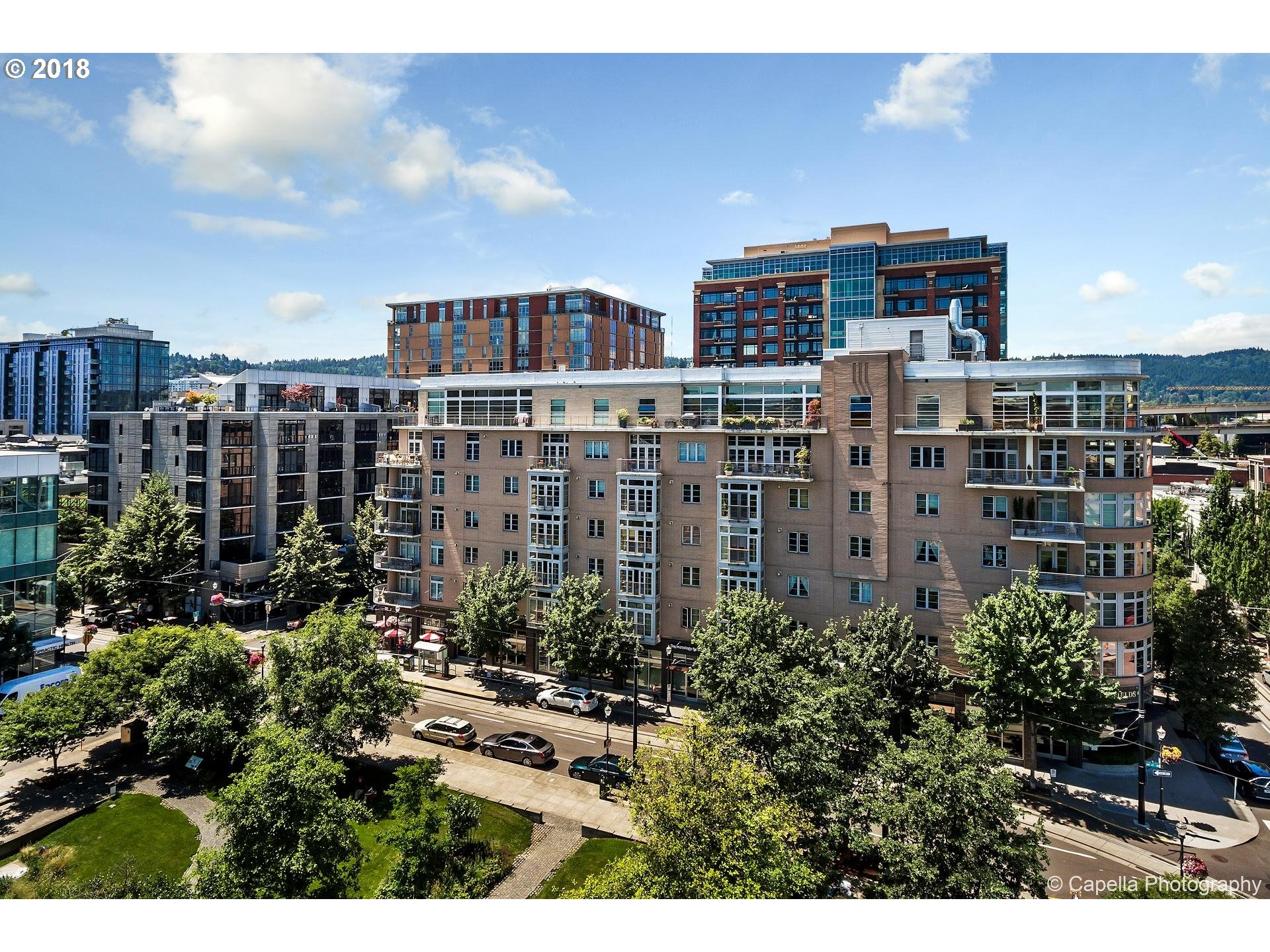 Spectacular floor plan-main living area has newly refinished Birch floors, gas fireplace, deck and eating bar and designated dining area,Lush green trees create serene environment, privacy and lovely view at Bridgeport condos on Tanner Springs Park Master suite overlooks quiet courtyard. Guest room on opposite end of unit with murphy bed and walk-in closet. New paint/carpet.