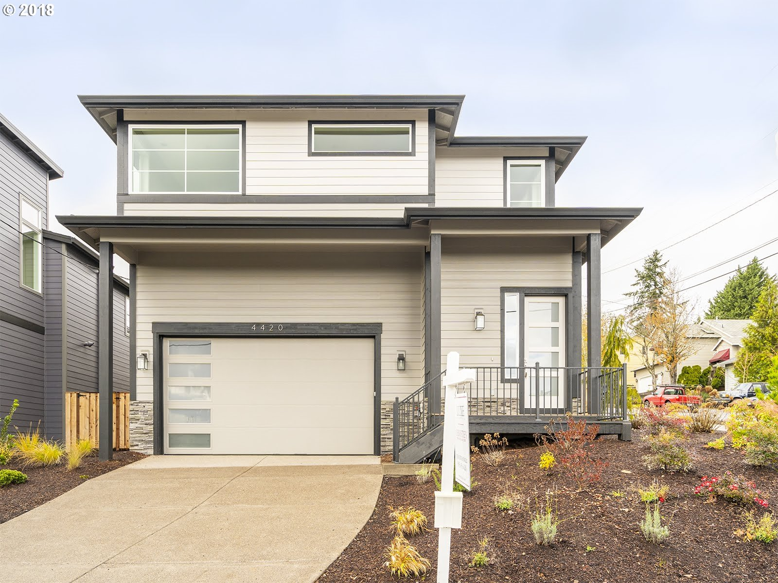 Brand new contemporary home on corner lot! Views of Mt. Hood! Move-in ready, open great room floorplan, hardwoods, S/S appliances, quartz counters, 3 bedrooms plus huge bonus room (or opt 4th). 5 piece master bath & walkin closet! Fenced backyard & covered patio perfect for entertaining.