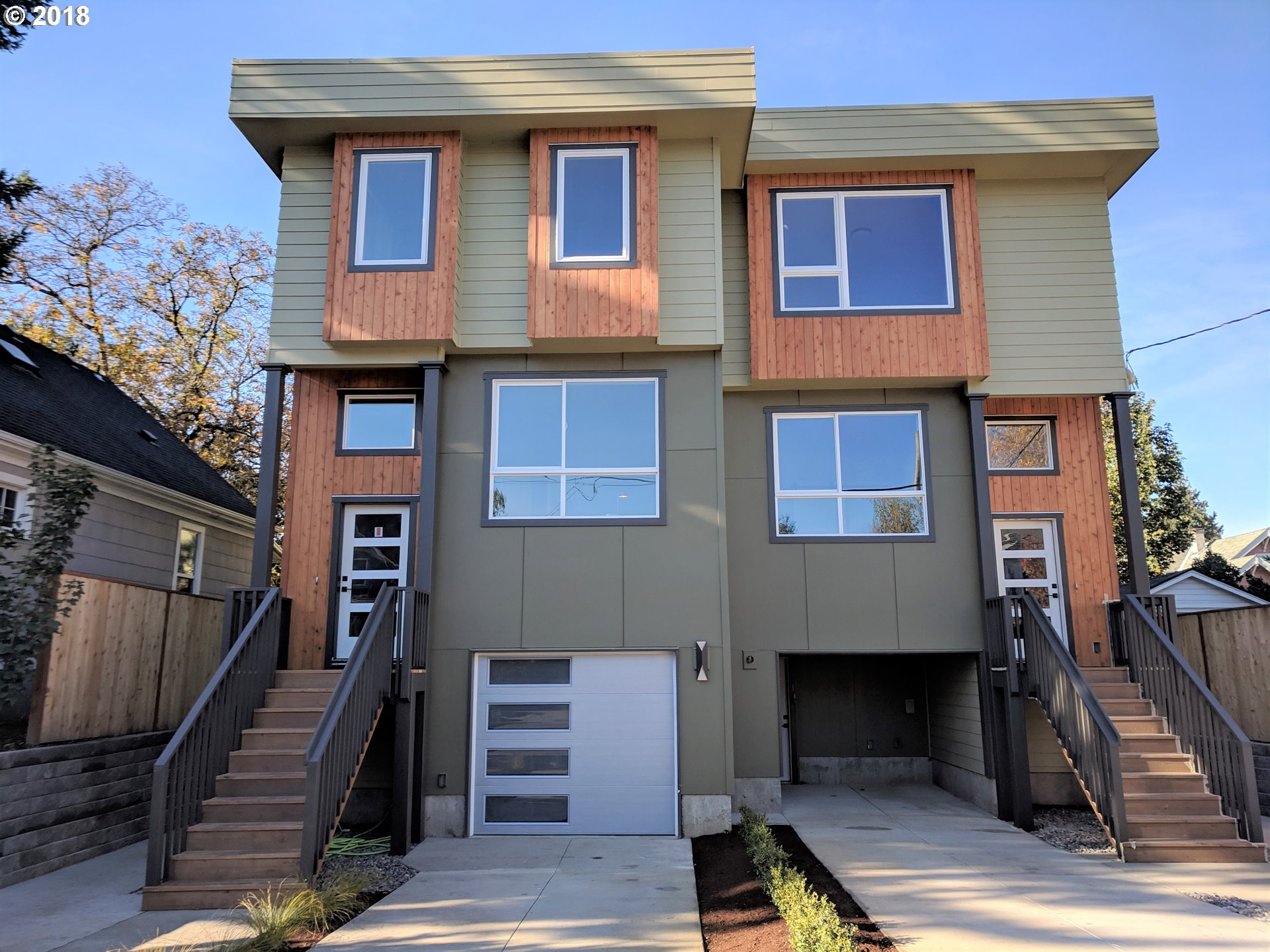 Brand new townhouse style condo with 4 bedrooms and 3 and one half bathrooms. Light and bright with tall ceilings and modern finishes. Approx 2800 square feet of living space with guest quarters in the basement. Over-sized deck with outdoor fireplace. Great for entertaining. Excellent location close to shops, public transportation, walker and biker friendly. [Home Energy Score = 6. HES Report at https://rpt.greenbuildingregistry.com/hes/OR10177053-20181116]
