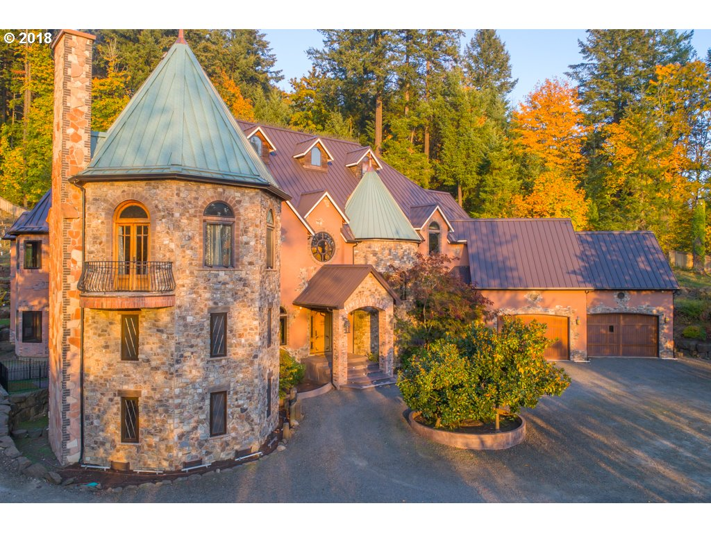 One-of-a-kind Portland icon, Blackberry Castle, on 6 acres with vineyard & underground wine cellar. Five bedrooms, 13,000 sq. ft. built in 2008 with incredible 2 story turret library, European village-style atrium bar & entertainment space, and home theater. Fully-equipped home gym with climbing wall, home spa with sauna and luxurious master suite. Entertainer's kitchen with deluxe appliances and huge central island in open great room.