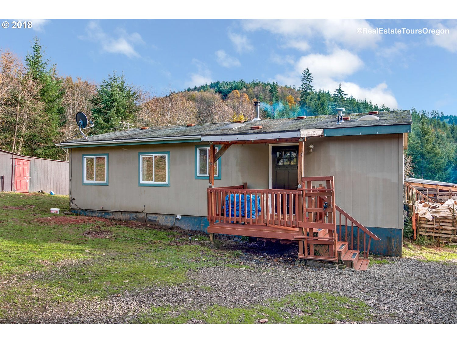 Cute & cozy manufactured home on a beautiful and private 6.04 acre lot. Well maintained and cared for inside and out. Enter to a vaulted kitchen with skylight, an abundance of cabinet space and separate dining area. Vaulted living room w/ wood-stove & slider to HUGE & COVERED back deck w/ gorgeous views to the Southern portion of the property. Master bedroom w/ attached bath with double sinks. Numerous outbuildings and space to play.