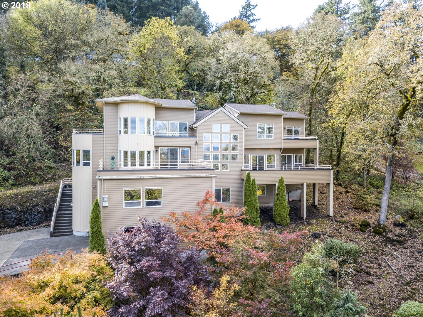 Fantastic mountain view contemporary on private acre+ sits in the heart of Bolton neighborhood.3 levels,5 decks, stunning master suite,2nd ensuite up.Fresh interior w/bamboo,travertine,new paint & carpet.Open kitchen/great-room flows to formal DR & LR. Deck access from almost every room. Main level office,bedroom,bath w/entrance- home business? Huge lower level media/game room. Plus33x60 studio w/full bath,gas heat.