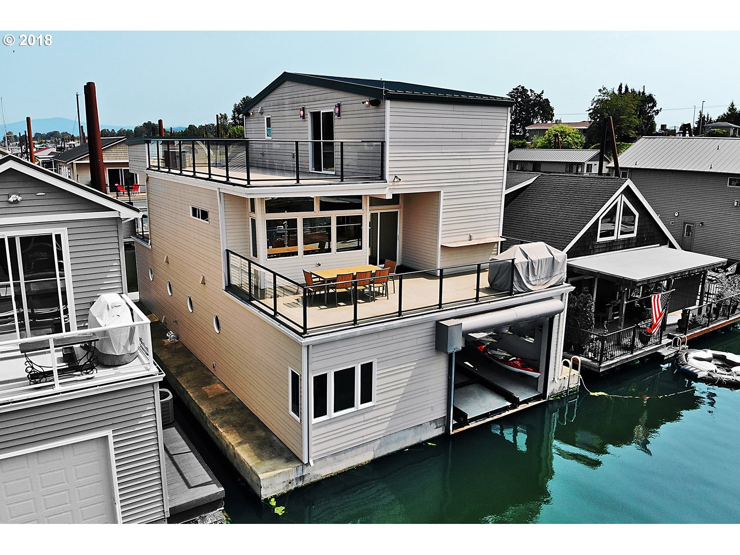 All 3 bedrooms w/ full bath in this custom flt hm built by  Marc Even. Own BOTH sides of the dock + 9x57 storage space across the St! Enjoy views of river from 3 decks.  High tech upgrades, including a whole-house sound system + Lutron brand lighting & shades. House incl finished boat well w/ heat & AC. 3rd bdrm on 3rd level w/large deck. Has CEMENT float. Earth Advantage Gold - see features list. This flt hm is a must see on the river!