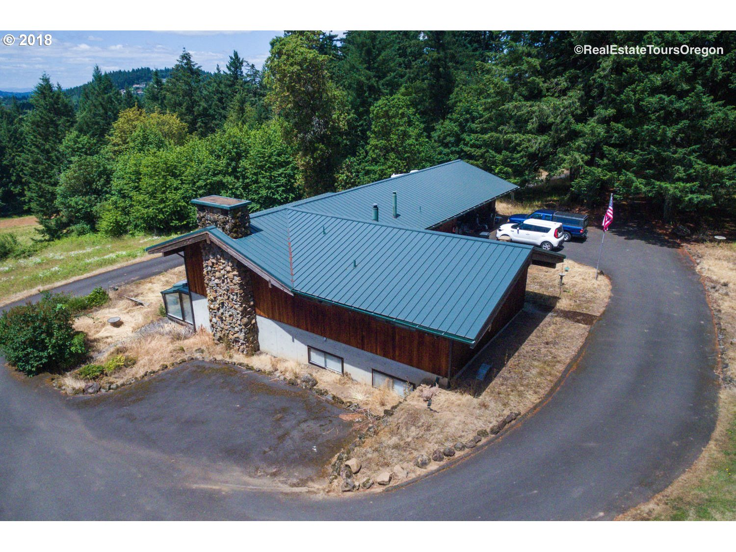 Excellent opportunity in highly desirable Stafford Hamlet. Large Shop and equipment barn. Good bones in this magnificent old NW Contemporary design.  Seller is a trust and will do no repairs. Seller will contribute $20,000 to installation of new septic.