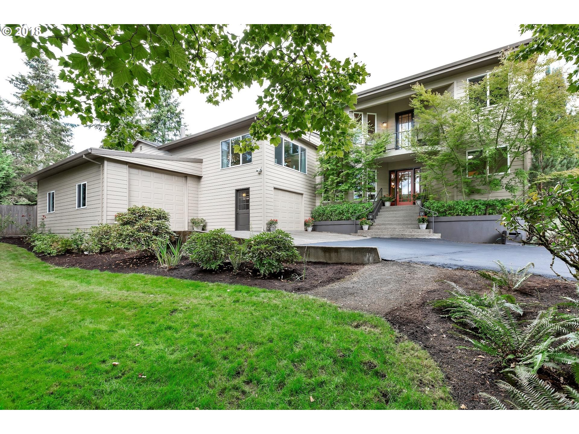 Extensively remodeled in 2000, this custom Ironwood home sits on .42ac w/lush gardens,level lawn, hottub, sportcourt & new deck. Interior flows w/new hardwood floors thru-out the entry, dining, living & light filled kitchen. A main floor bedroom ensuite provides an array of options; oversized Master Suite (upper) w/sitting area & fireplace; two add'l bedrooms w/large WI closets & shared secret loft. Oversized garage w/RV bay & workshop.