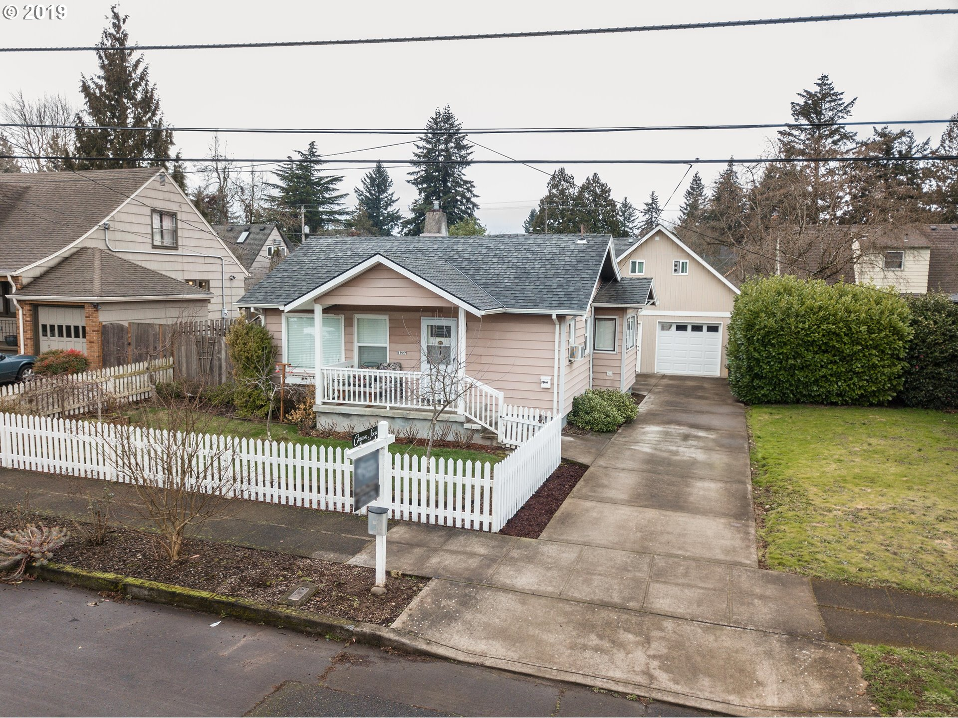 Charming Portland bungalow with converted garage/shop area with loft. Such a great location next to Rose City Park and Golf Course! Gorgeous yard with Summer blooms and a Tuff Shed for the gardener; RV parking and oversized one-car garage with loft ideal for work-at-home studio or hobbies. Finished basement with workshop for some extra privacy.