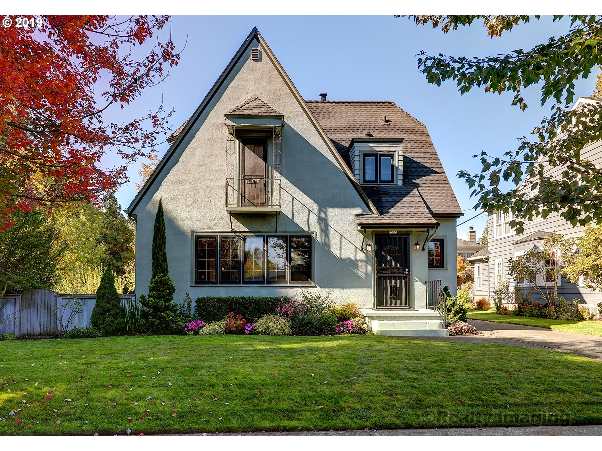 From the days of old Portland. Meticulously maintained English Tudor that backs up to Grant Park. Beautiful original leaded windows,stained glass,hardwood floors,French doors,kitchen nook & gas fireplace. Basement is a finished bonus space, plus room for a shop/craft area.Step out into an entertainers dream backyard. separate building 2 car garage.Driveway is not shared. Near greatly rated schools, cafes, transit, trails and bikeways. [Home Energy Score = 2. HES Report at https://rpt.greenbuildingregistry.com/hes/OR10098797]