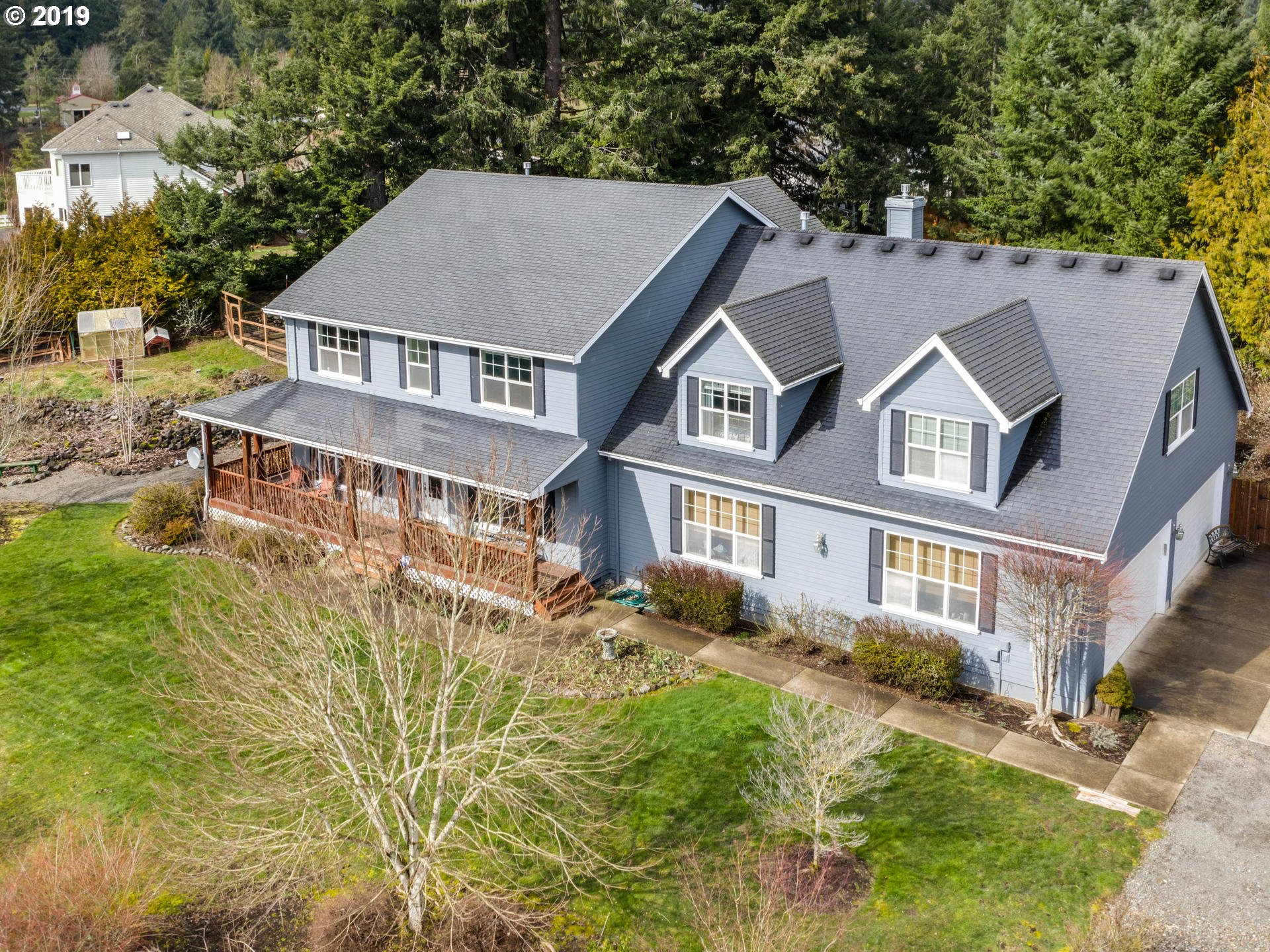 This custom built Oregon City home has a beautiful setting, wrap around porch with open views to the SE! Features 5 bedrooms up + a den/office on main floor, 3 1/2 baths, Very Large kitchen w/island, 2 sinks, 2 ovens & 2 refrigerators! Family Rm off kitchen w/fireplace & extra storage. Huge bonus rm up currently used as in-law quarters! Oversized 4 car garage has room for shop and plenty of parking. Fenced back yard w/paver patio area.
