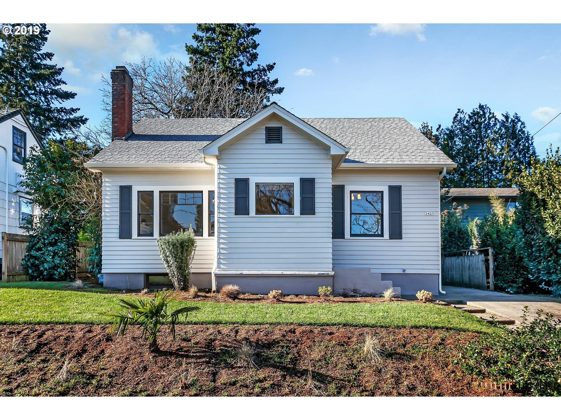 Located in Portland's Rose City Park neighborhood, this home has been thoughtfully renovated with quality finishes and fixtures throughout. Features include beautiful wood floors, a brand new kitchen, and updated bathrooms. The living room has large windows that bring in plenty of natural light & a cozy fireplace w/ built-ins. Relax in the sunroom off of the kitchen, with a view of the fenced backyard. Ideal location off of NE Fremont!