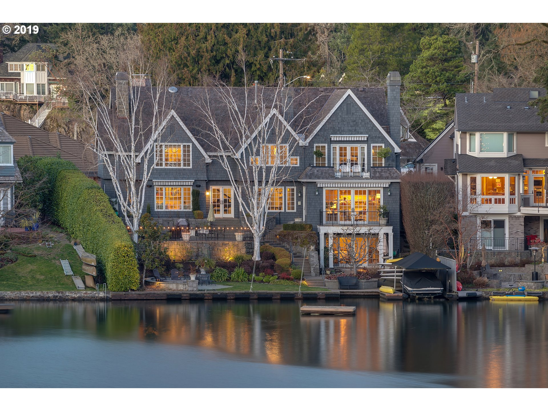 Waterfront Lake Oswego home on The Peninsula of the main lake. Four bdrms with 2 lake view master suites & 4 floors of living space. Built in 1936 & remodeled with historical charm & modern amenities. Combo high/low bank with covered slip w/lift & floating dock. Classic design warm hardwoods, open kitchen/great room, formal living & dining, 2nd family/game room & home gym. Tiered backyard with patio, grass & fire pit on lower lake level